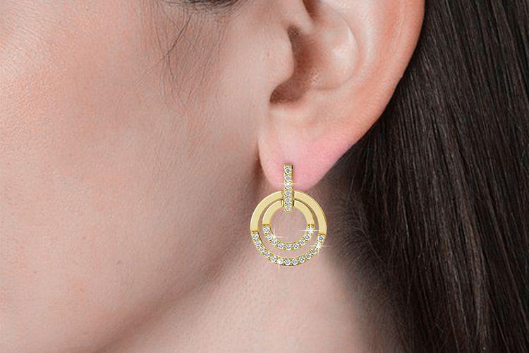 Goudkleurige oorbellen met zirkonia-steentjes