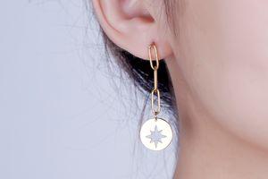 Goudkleurige oorbellen van Di Lusso