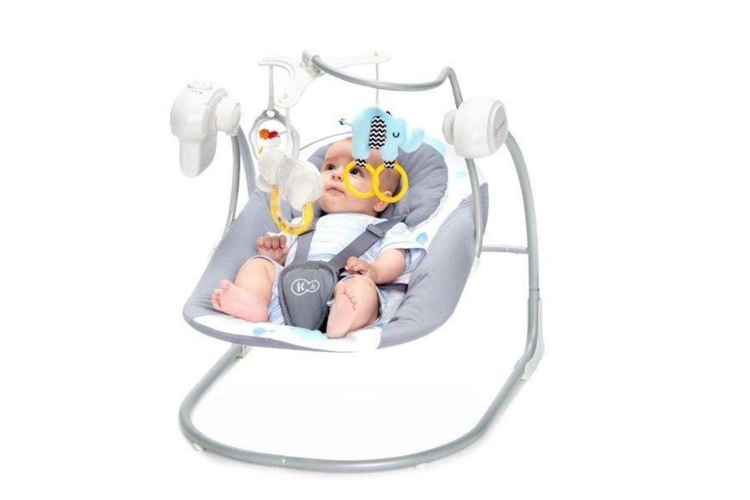 Babyschommel met speeltjes en muziek